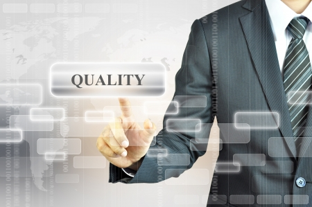 satisfy: Businessman touching QUALITY sign Stock Photo