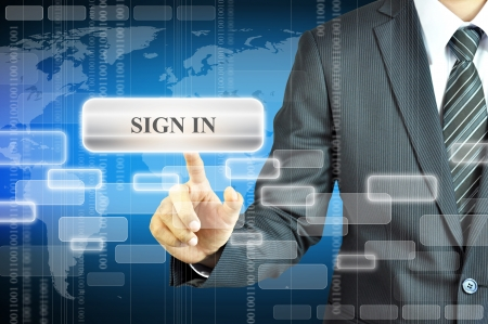 Businessman touching SIGN IN icon photo
