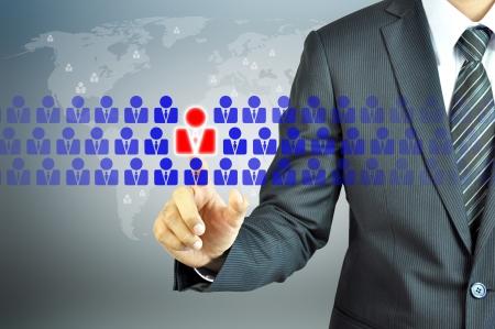 relaciones humanas: Empresario apuntando signo humano - HR, gestión de recursos humanos, desarrollo de recursos humanos, el concepto de CRM Foto de archivo