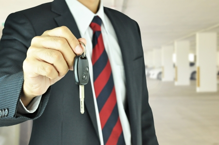 Businessman giving a car key Stock Photo - 21014080