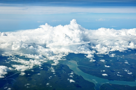 birdeye: Aerial view of cloudy sky, river and forest Stock Photo