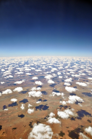 birds desert: Sky, clouds and desert - aerial view of the earth Stock Photo