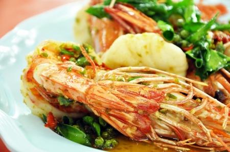 Stir-fried King prawns with chili and Kaffir limes leaves - Thai food photo