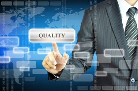 satisfied customer: Businessman touching QUALITY sign Stock Photo