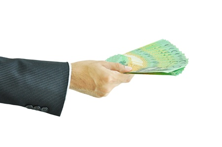 australian money: Businessman hand holding money - Australian Dollar Banknotes