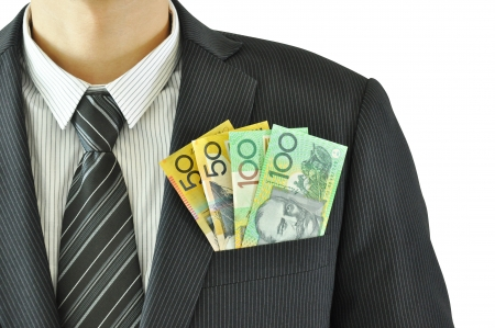 Money in businessman suit pocket - Australian Dollar banknotes photo