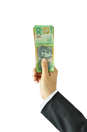 Businessman hand holding money - Australian Dollar Banknotes photo