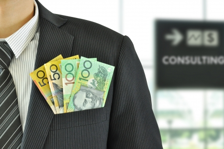 Money in businessman suit pocket - Australian Dollar bills photo