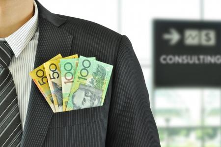 australian dollar notes: Money in businessman suit pocket - Australian Dollar bills
