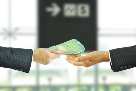 australian dollar notes: Businessman hand giving money - Australian Dollar Bills
