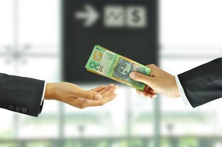 Businessman hand sending money Stock Photo