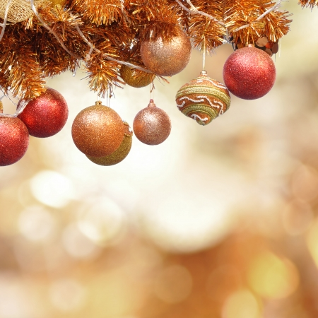 Christmas ornaments on lens flare background