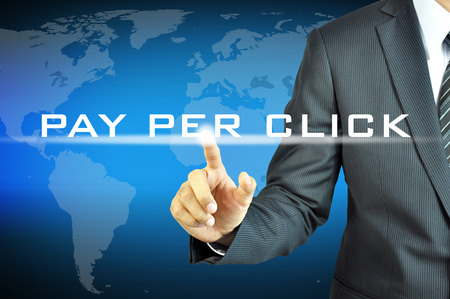 publisher: Businessman touching  PAY PER CLICK sign on virtual screen Stock Photo