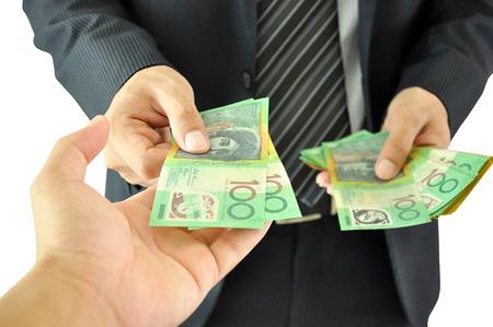 australian dollars: Businessman hand giving money  - Australian dollars