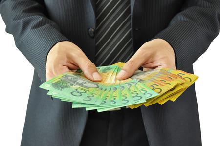 australian money: Businessman hands holding money  - Australian dollar bills