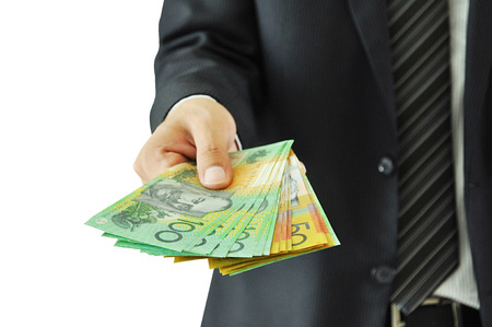 australian dollars: Businessman giving money  - Australian dollars