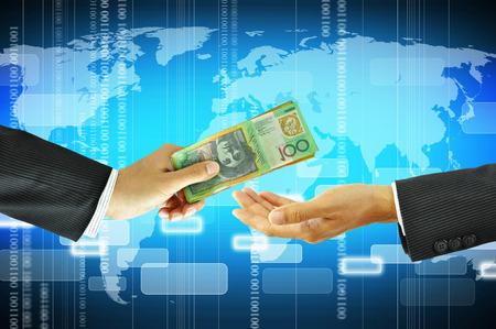 australian dollar notes: Businessman hands receiving money - Australian dollars