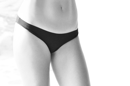 lower body: Woman body in bikini - monochrome