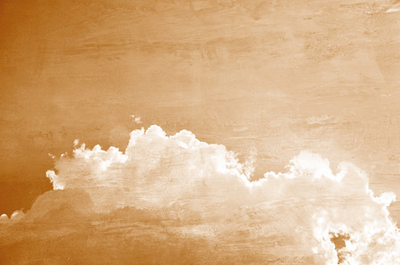 Retro style picture of sky and clouds with sepia effect photo