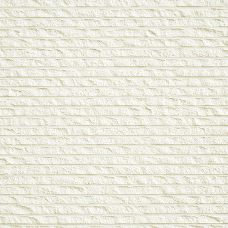 grooves: Rough white grooved decorative stone wall texture as background
