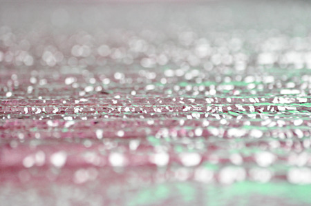 grooved: Water flow on grooved stone - bokeh abstrcat background