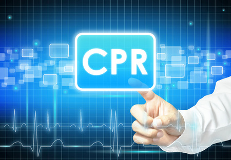 Hand touching CPR sign on virtual screen - health care & medical concept photo