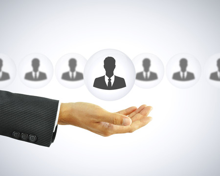 leadership management: Hand holding businessman icon -  business abstract - HR concept