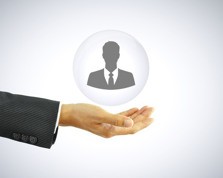 Hand holding businessman icon -  business abstract - HR concept photo