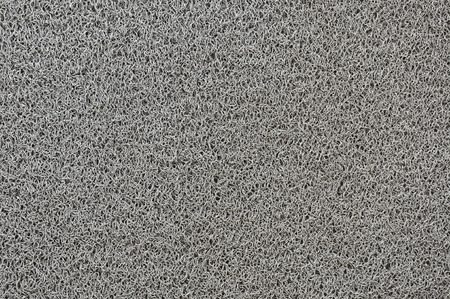 Gray synthetic fiber texture of  household scrubber photo