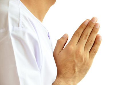 buddhism prayer belief: Hands gesturing Wai or Sawasdee - respect sign mostly used in Southeast Asia Stock Photo