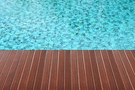 pool deck: Brown wood plank over swimming pool water