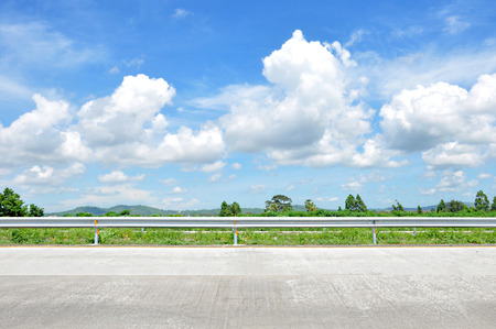 Beautiful roadside view with green nature and blue sky  background