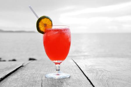 mocktail: Cocktail drink with orange slice as a garnish on old wooden table