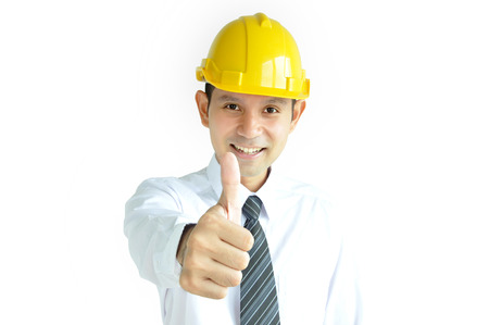 asian architect: Smiling Asian engineer (or architect ) with yellow hard hat giving thumbs up on architectural sketch background