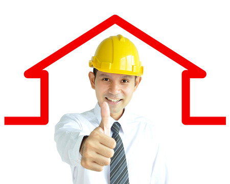 asian architect: Smiling Asian architect (or engineer ) with yellow hard hat giving thumbs up on home outline background