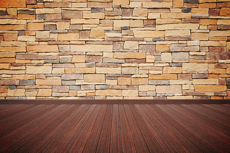 overlapped: Wooden floor with stone wall  Stock Photo