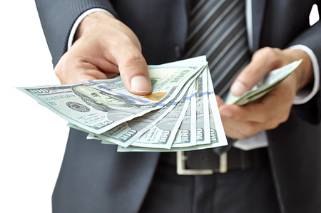 inducement: Hand giving money - United States Dollars (or USD)