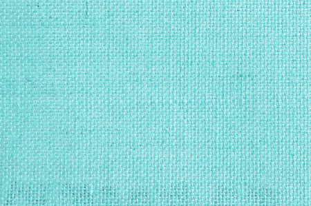 Jute or hessian fabric texture in blue color as background