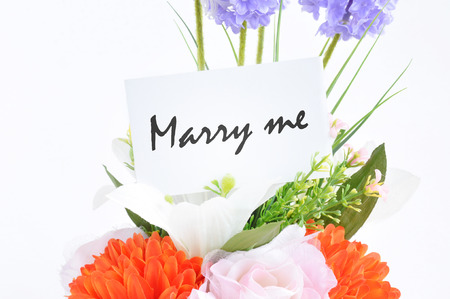 marry me: Flower bouquet with   Marry me   on  tag card - marriage proposal concept