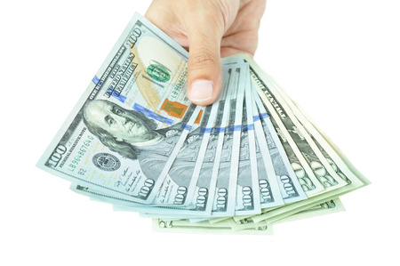 inducement: Money - hand holding banknotes - United States Dollars or USD