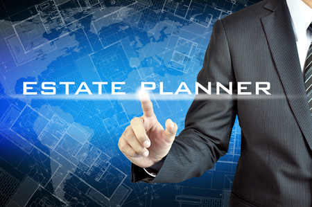 Businessman hand pointing to ESTATE PLANER sign on virtual screen photo