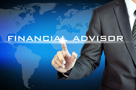 Businessman hand pointing to FINANCIAL ADVISOR sign on virtual screen Foto de archivo