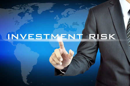 investment risk: Hand touching INVESTMENT RISK words on virtual screen - investment & financial planning concept