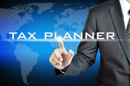 planner: Hand touching TAX PLANNER words on virtual screen - business & financial planning concept Stock Photo