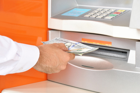 automatic teller machine bank: Hand taking (withdraw) money from ATM