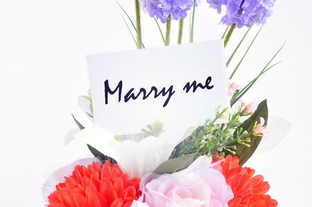 marry me: Flower bouquet with   Marry me   on  tag card - retro style lighting effect Stock Photo