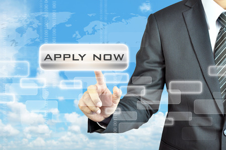 Businessman hand touching APPLY NOW button on virtual screen photo