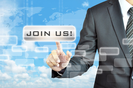 Businessman hand touching JOIN US sign on virtual screen photo