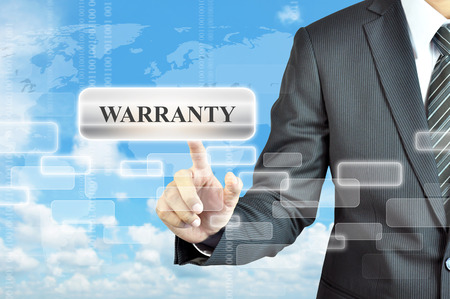 long lasting: Businessman hand touching WARRANTY sign on virtual screen