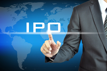 public offering: Businessman hand touching IPO  or Initial Public Offering   sign on virtual screen - stock   investment concept